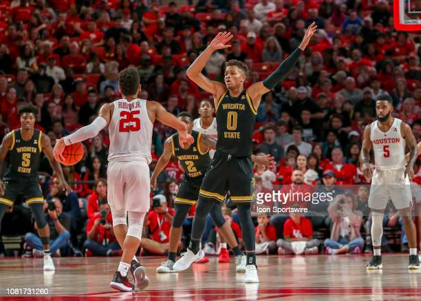 Wichita State Shockers guard Dexter Dennis guards Houston Cougars guard Galen Robinson Jr during the basketball game between the Wichita State...