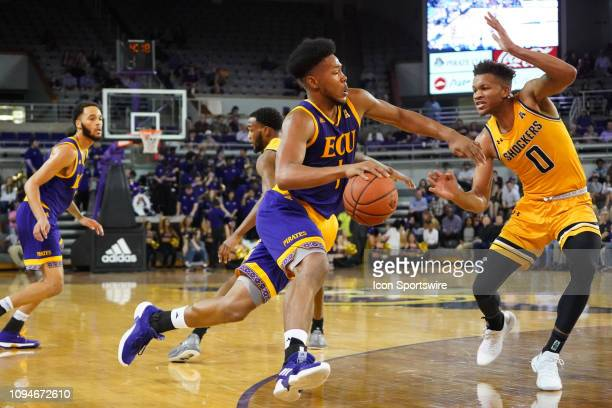 Wichita State Shockers guard Dexter Dennis swings over to cover a charging East Carolina Pirates forward Jayden Gardner during a game between the...