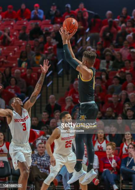 Wichita State Shockers guard Dexter Dennis takes a threepoint shot during the basketball game between the Wichita State Shockers and Houston Cougars...