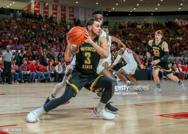 Wichita State Shockers guard Ricky Torres pivots to pass the ball during the basketball game between the Wichita State Shockers and Houston Cougars...