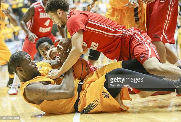 Wichita State Shockers' Lufile Chadrack battles for a loose gal with Illinois State Redbirds' Kaza Keane during the second half at Koch Arena in...