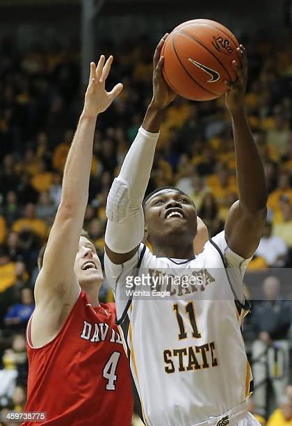 Wichita State's Cleanthony Early goes up for a shot against Davidson's Tyler Kalinoski during the second half at Koch Arena in Wichita Kan Sunday Dec...