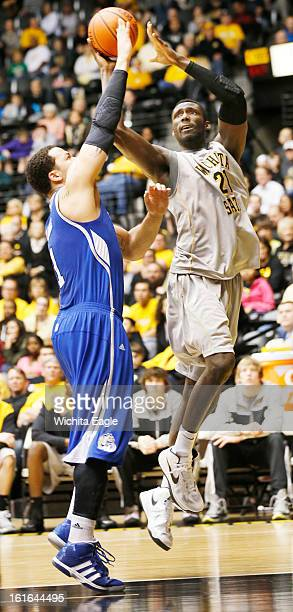 Wichita State's Ehimen Orukpe right is fouled while driving to the basket against Drake's Jordan Clarke in the second half at Koch Arena in Wichita...