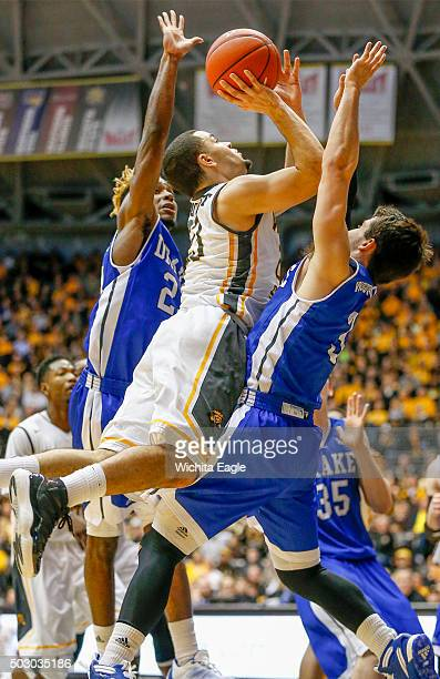 Wichita State's Fred VanVleet middle draws a foul as he drives to the basket against Drake in the second half at Koch Arena in Wichita Kan on...