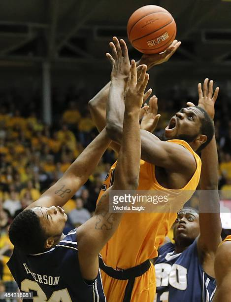 Wichita State's Kadeem Coleby shoots over Oral Roberts' Denell Henderson left and Shawn Glover during the first half at Koch Arena in Wichita Kan on...
