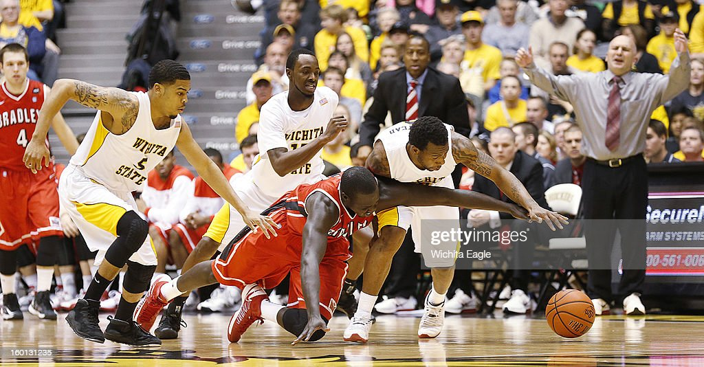 Wichita State's Malcolm Armstead, right, steals the ball from Bradley's Shayok Shayok in the second half at Koch Arena in Wichita, Kansas, Saturday, January 26, 2013. WSU defeated Bradley, 73-39.