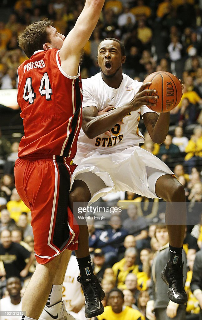 Wichita State's Nick Wiggins gets fouled as he drives to the basket against Bradley's Jordan rosser in the second half at Koch Arena in Wichita, Kansas, Saturday, January 26, 2013. WSU defeated Bradley, 73-39.