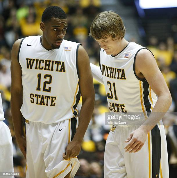 Wichita State's Ron Baker leans on his teammate Darius Carter after Baker fell hard in the first half against Loyola at Koch Arena in Wichita Kan on...