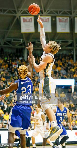 Wichita State's Ron Baker shoots against Drake's Ore Arogundade in the first half at Koch Arena in Wichita Kan on Thursday Dec 31 2015 Wichita State...