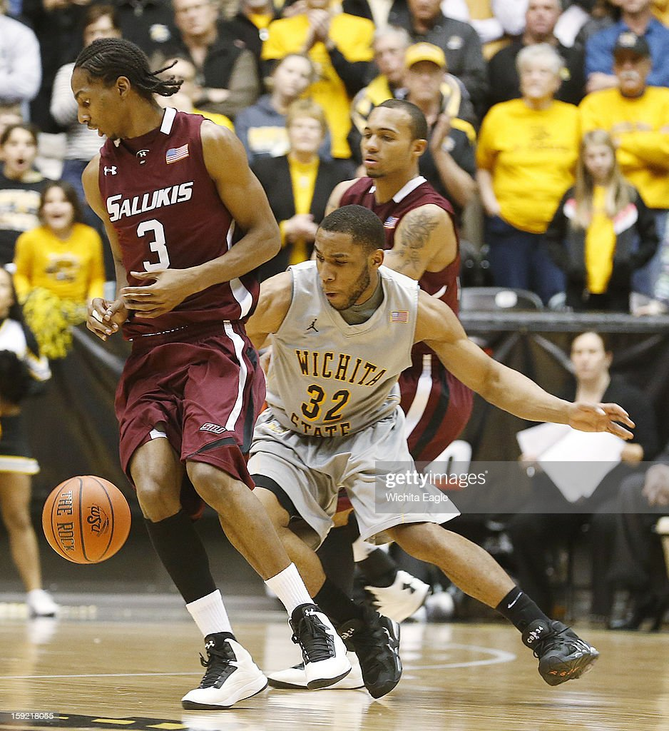 Wichita State's Tekele Cotton (32) steals the ball from Southern Illinois' Desmar Jackson (3) in the second half at Koch Arena in Wichita, Kansas, on Wednesday, January 9, 2013. The host Shockers won, 82-76.