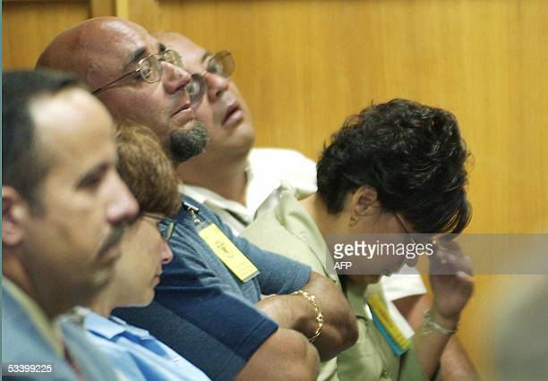 Charlie Otero and other members of the Otero family listen to testimony that described the 1974 murders of four of their relatives on the first day...