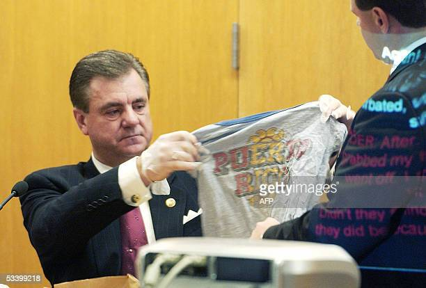 Larry Thomas of the Kansas Bureau of Investigation holds up a tshirt that was taken from the head of Joey Otero a young victim of the admitted BTK...