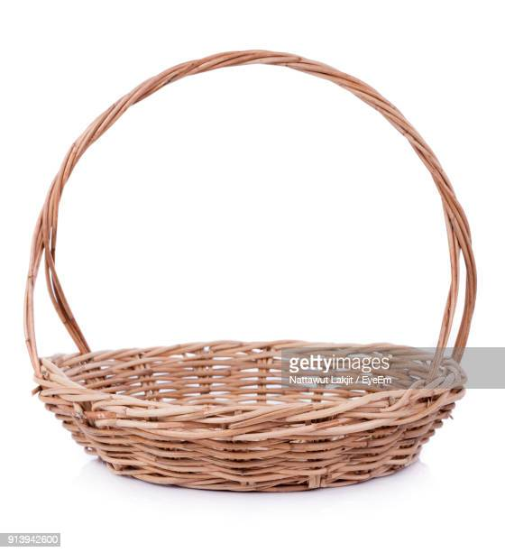 wicker basket against white background - basket stock photos and pictures