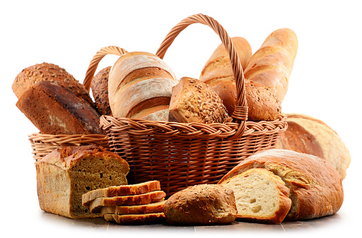 Wicker basket with assorted baking products isolated on white 517275318