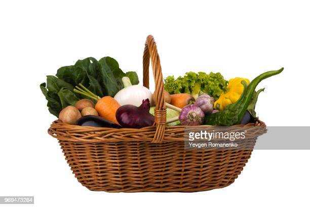 wicker basket with vegetables isolated on a white background - basket stock photos and pictures