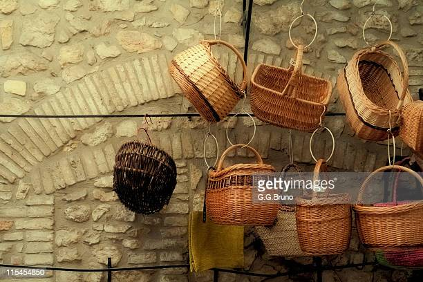 Wicker baskets hung on wall of stone