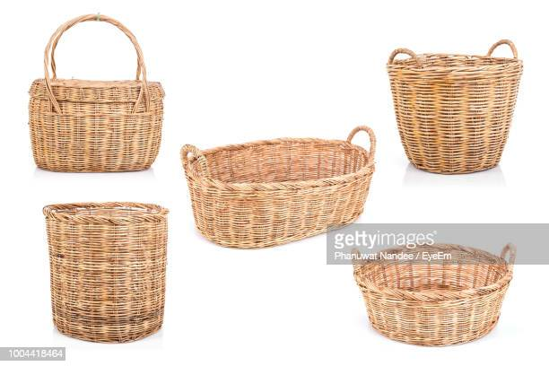 wicker baskets on white background - basket stock photos and pictures