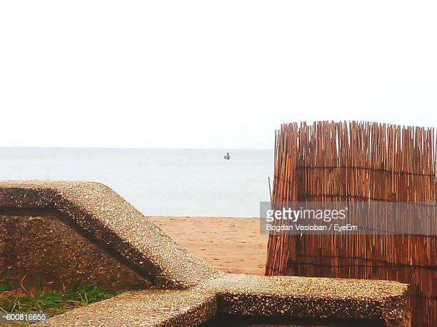 Wicker Fence On Beach Against Clear Sky