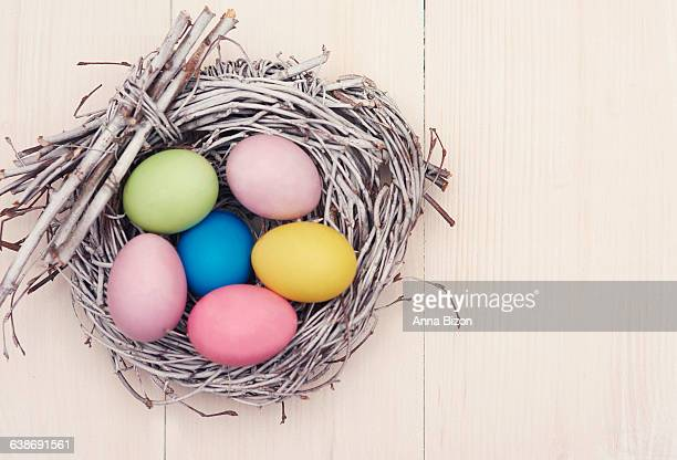 Wicker nest full of multi colored eggs. Debica, Poland
