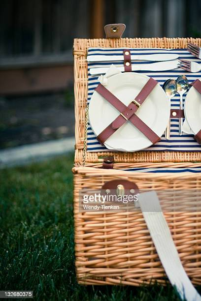 Wicker picnic basket with dishes