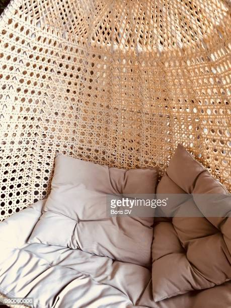wicker swing chair with pillows - wicker stock pictures, royalty-free photos & images