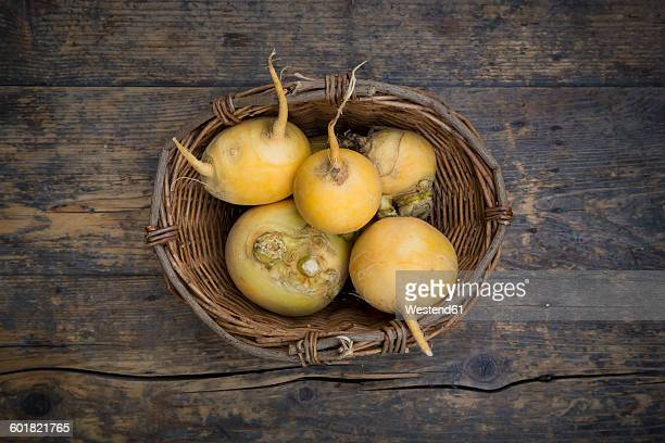 wickerbasket of swedes on dark wood - rutabaga stock pictures, royalty-free photos & images