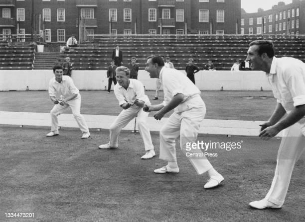 Wicket- keeper Alan Knott, Derek Underwood, Colin Cowdrey and Geoffrey Arnold of England undertake catching practice before the 3rd Test Match...