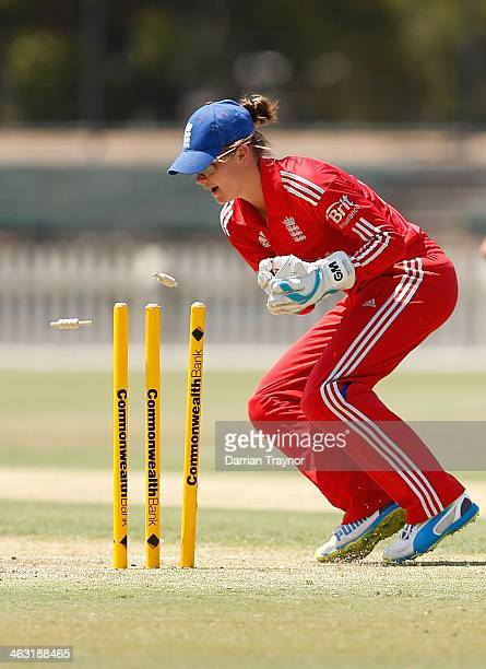 Wicket keeper Amy Jones lof England looks on as Rachael Haynes of Victoria is run out during the International Tour match between the Chairman's XI...