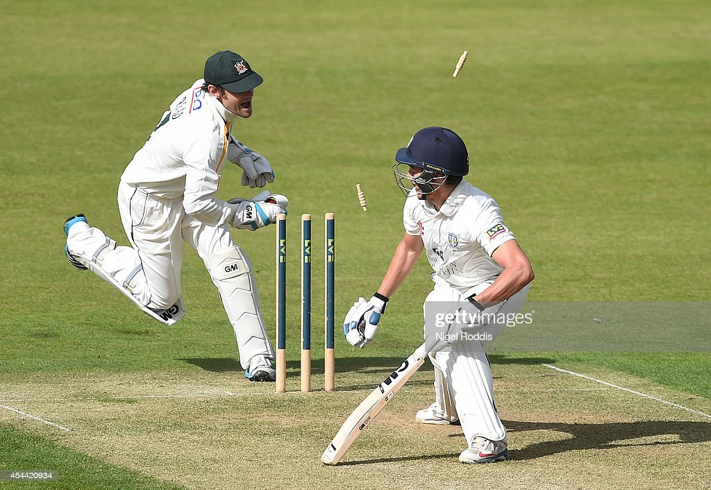 Wicket keeper Chris Read (L) of Nottinghamshire stumps Michael Richardson of Durham during the LV County Championship match between Durham and Nottinghamshire at The Riverside on August 31, 2014 in Chester-le-Street, England.