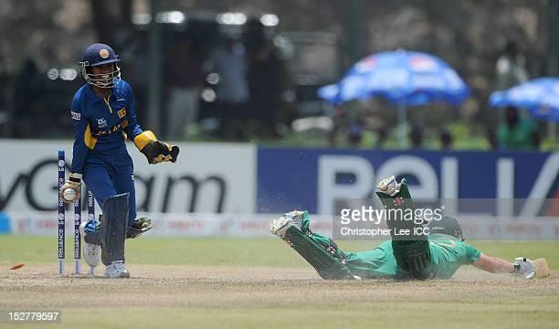 Wicket keeper Dilani Manodara of Sri Lanak celebrates running out Mignon Du Preez of South Africa during the ICC Women's World Twenty20 Group B match...