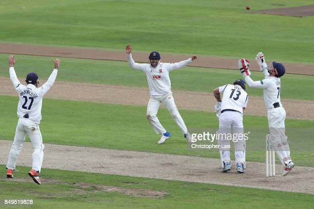 Wicket Keeper James Foster of Essex throws the ball in the air as he and his team mates celebrate taking the wicket of Gareth Berg of Hampshire...