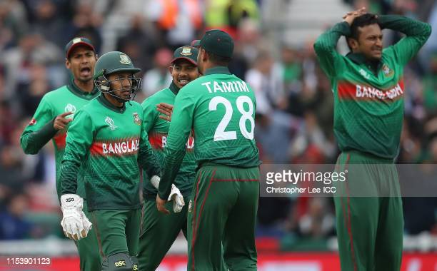 Wicket keeper Mushfiqur Rahim of Bangladesh talks to Tamin Iqbal Khan after he nearly runs out Kane Williamson of New Zealand during the Group Stage...
