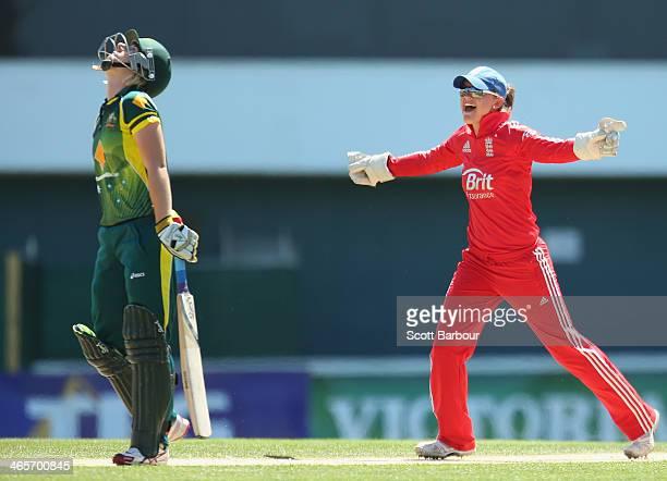 Wicketkeeper Amy Jones f England celebrates as Elyse Villani of Australia is dismissed during game one of the International Twenty20 series between...