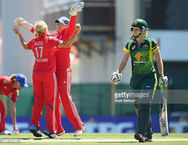 Wicketkeeper Amy Jones of England celebrates with Danielle Hazell after she dismissed Elyse Villani of Australia during game one of the International...