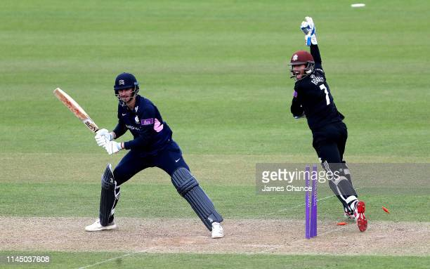 Wicketkeeper Ben Foakes of Surrey celebrates after stumping Toby RolandJones of Middlesex who reacts during the Royal London One Day Cup match...