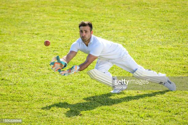 wicketkeeper catching the ball - sport of cricket stock pictures, royalty-free photos & images