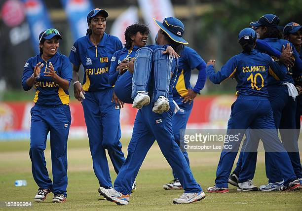Wicketkeeper Dilani Manodara of Sri Lanka is carried by Chamari Athapaththu as they celebrate their victory during the ICC Women's World Twenty20...