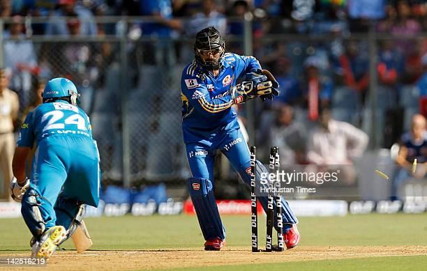 Wicketkeeper Dinesh Karthik of the Mumbai Indians stumps captain Sourav Ganguly of the Pune Warriors during the IPL 5 match between the Mumbai...