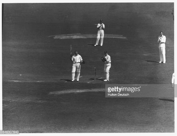 Wicketkeeper Duckworth looks on as batsman Don Bradman acknowledges the crowd during his record innings against England at the Oval. England, 1930. |...