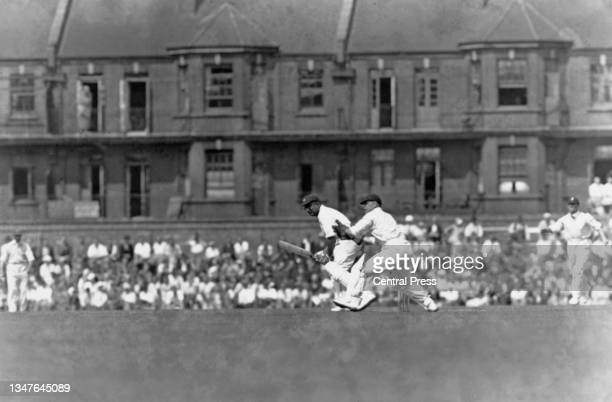 Wicketkeeper Edward Brooks looks on as Maharajkumar of Vizianagram , right handed batsman and team captain for the touring Indian cricket team plays...