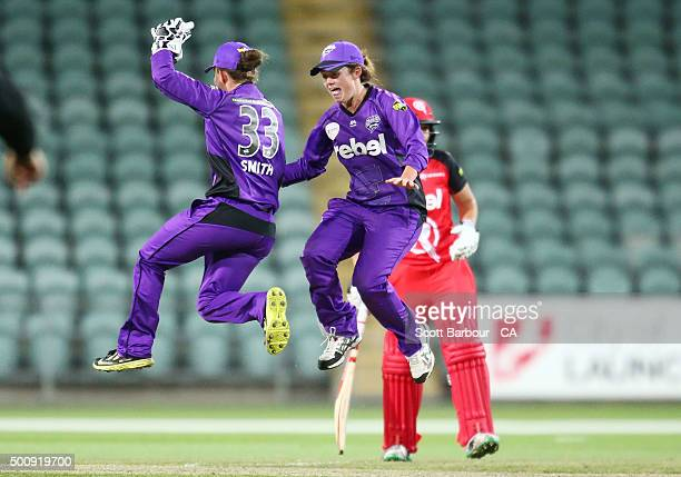 Wicketkeeper Emily Smith and Corinne Hall of the Hurricanes celebrates after running out Kris Britt of the Renegades during the Women's Big Bash...