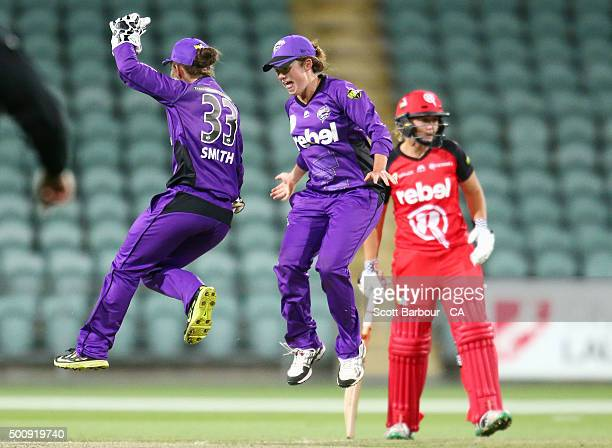 Wicketkeeper Emily Smith and Corinne Hall of the Hurricanes celebrate after running out Kris Britt of the Renegades during the Women's Big Bash...