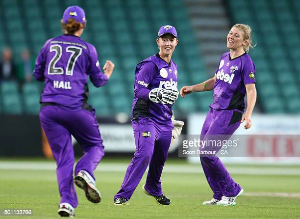 Wicketkeeper Emily Smith of the Hurricanes celebrates with Heather Knight after stumping Sophie Devine of the Strikers during the Women's Big Bash...