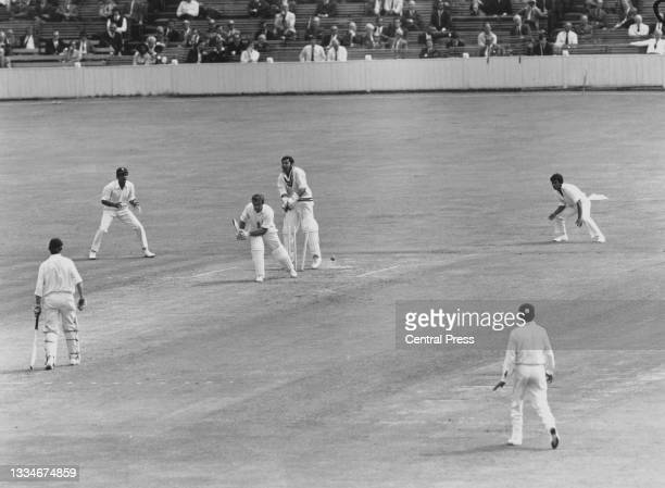 Wicketkeeper Farokh Engineer of India looks on from behind the stumps as John Edrich of England is bowled off a delivery by Bhagwath Chandrasekhar of...