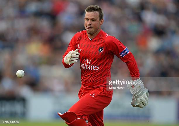 Wicketkeeper Gareth Cross of Lancashire chases after a top edge from Michael Carberry of Hampshire during the Friends Life T20 Quarter Final between...
