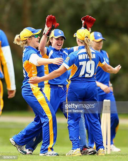 Wicketkeeper Laura Wright of the ACT celebrates with Sally Moylan after running out Sarah Elliott of Victoria during the WNCL match between Victoria...