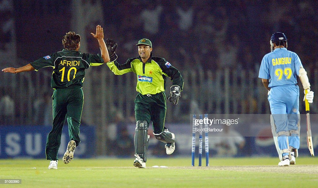 Wicketkeeper Moin Khan (C) celebrates with bowler Shahid Afridi (L) of Pakistan after stumping Sourav Ganguly of India during the second Pakistan v India one day international match played at Pindi Cricket Stadium March 16, 2004 in Rawalpindi, Pakistan.