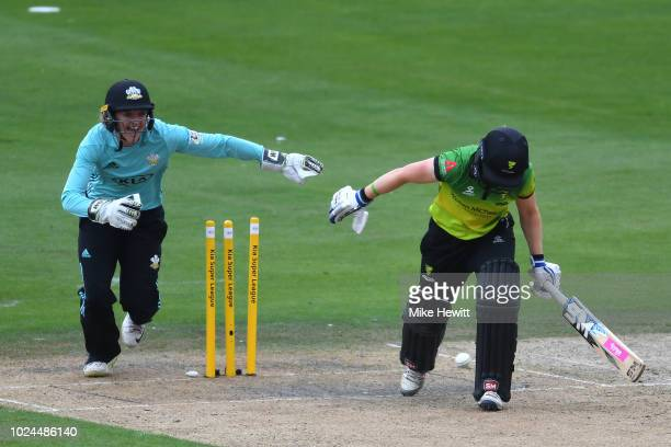 wicketkeeper Sarah Taylor of Surrey Stars celebrates as Heather Knight of Western Storm is bowled by Sophia Dunkley during the semifinal between...