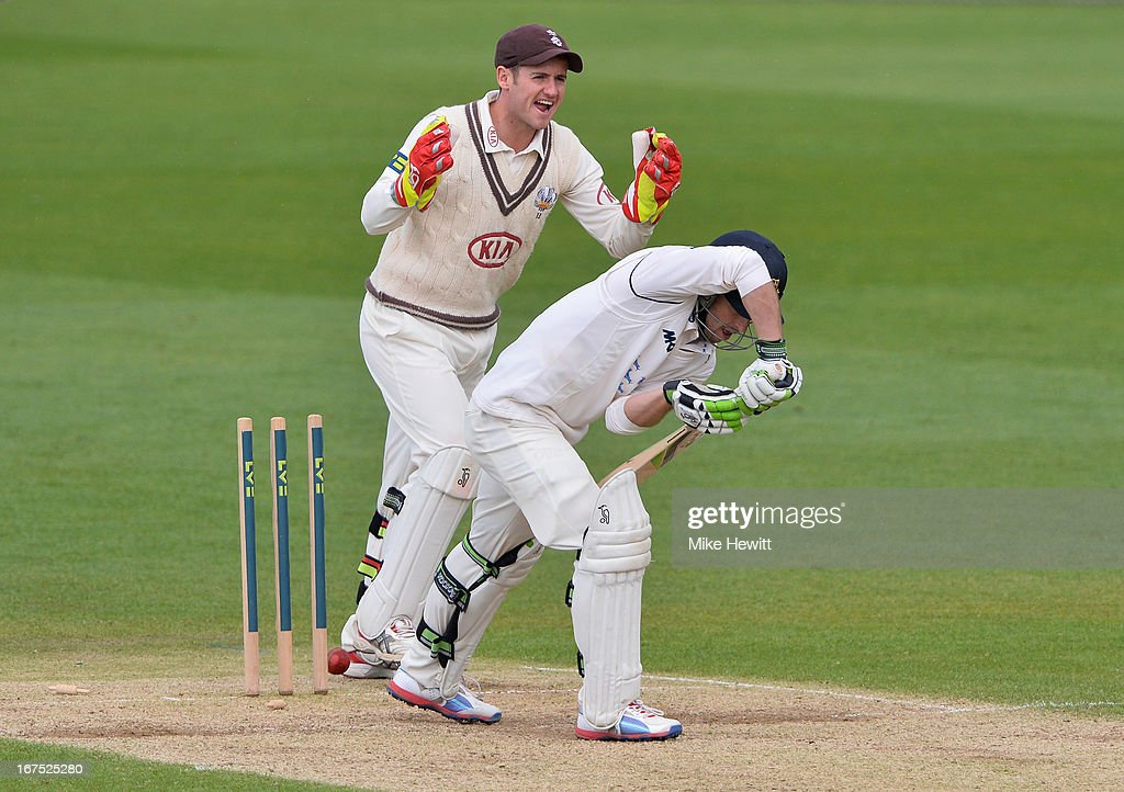 Wicketkeeper Steven Davies celebrates as Ed Joyce of Sussex is bowled by Gareth Batty for 98 during day three of the LV County Championship Division One match between Surrey and Sussex at The Kia Oval on April 26, 2013 in London, England.
