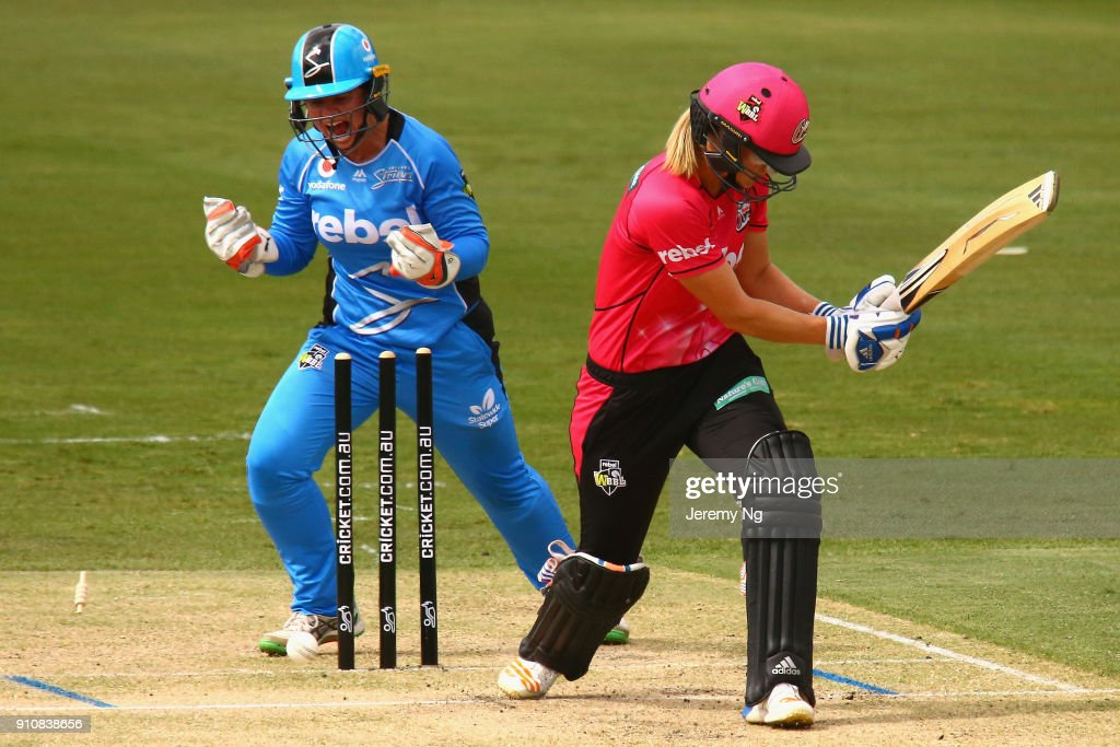 Wicketkeeper Tegan McPharlin of the Strikers celebrates the wicket of Ellyse Perry of the Sixers during the Women's Big Bash League match between the Adelaide Strikers and the Sydney Sixers at Hurstville Oval on January 27, 2018 in Sydney, Australia.